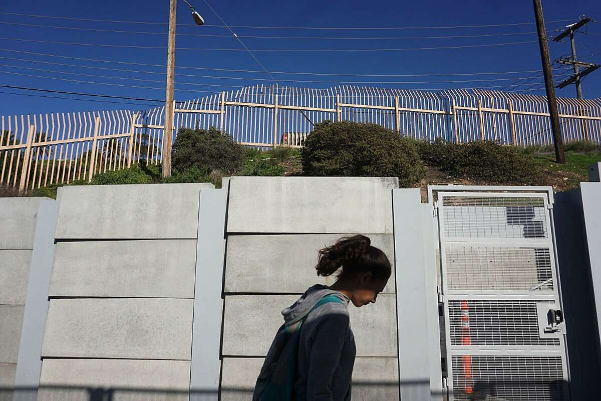 Today, millions of immigrants work on American farms, in retail, and elsewhere. With a DACA repeal, the national GDP could take a $460.3 billion loss over the next 10 years. Above, a view of the U.S.-Mexico border wall on January 25, 2017 in San Ysidro, California.