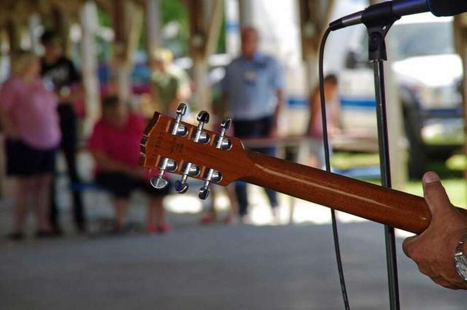 Visitors enjoy live music during Saturday's Jerseyville Music Festival. Photo: Photos By David Blanchette | For The Telegraph