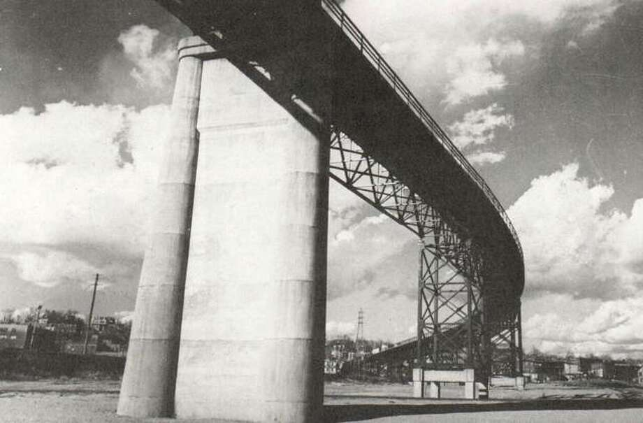 The graceful curves of the Clark Bridge are seen from below, in the area once known as the Burlington Pocket, where Riverside Park and ball diamonds were later located. Many motorists admit, however, graceful the curves are, that the Clark Bridge requires some careful driving to navigate the curves.