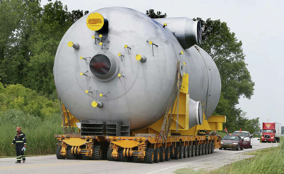 A 90-foot-long, 330-ton reactor makes its way up Robins Road to Illinois Route 111 Wednesday on its trek from the Mississippi River to the Phillips 66-operated Refinery in Roxana. The unit is used to control reactions in the making of gasoline and will replace an older unit. Photo: John Badman | The Telegraph