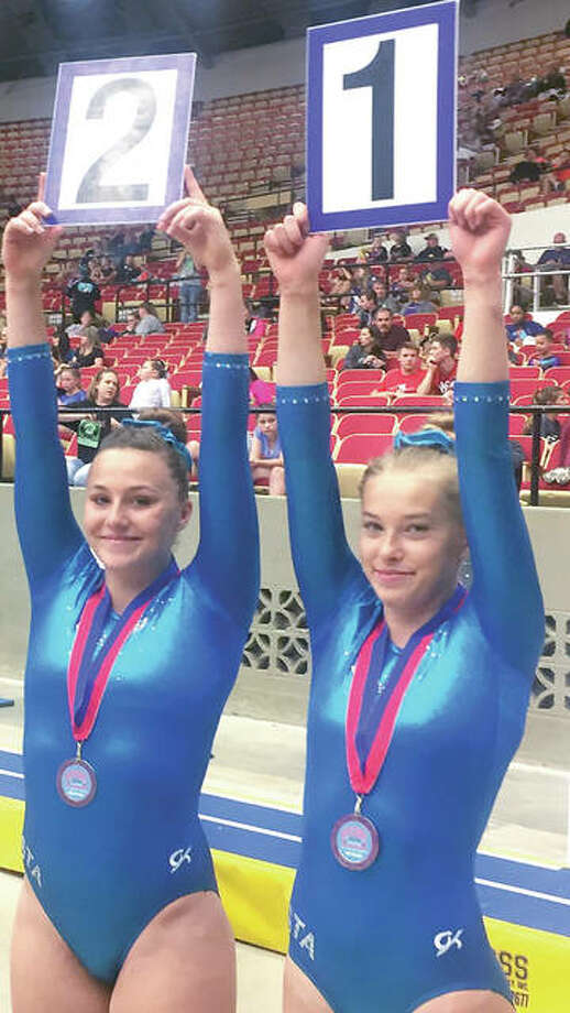 Mackenzie Butler from Mid Illinois Gymnastics, right, finished in first place in Advanced Tumbling for ages 15-16 and third in Elite girls open age group tumbling at the recent United States Tumbling and Trampoline National Championships. Teammate Amber Exton, left, was third in Advanced 15-16 and 10th in Elite. Teammate Amber Exton was third in Advanced 15-16 and 10th in Elite, even though she suffered an injury in warmups for Elite competition.