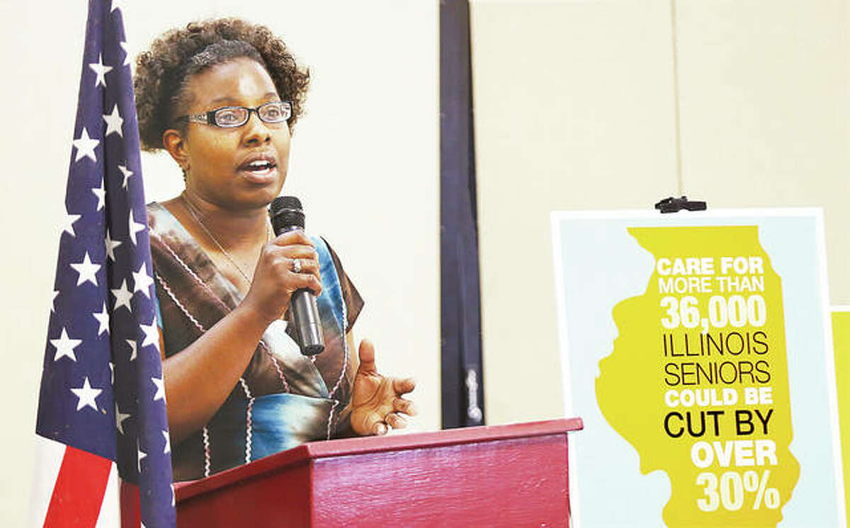 Charrease Frazier, a home health care worker, talks at a press conference held Thursday at Senior Services Plus in Alton to protest proposed cuts by Illinois Gov. Bruce Rauner to the Community Care Program. The cuts could affect 36,000 Illinois seniors.