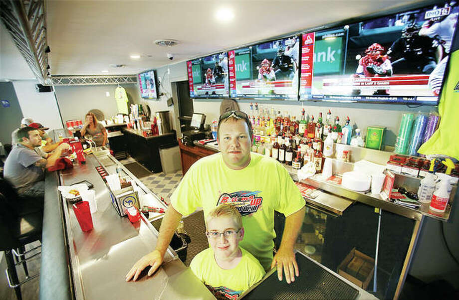 Josh Carroll, owner of the new Bottoms Up Sports Bar and Grill on Fosterburg Road in Alton, stands with his 9-year-old son, Blake, in the recently opened establishment. Photo: John Badman|The Telegraph
