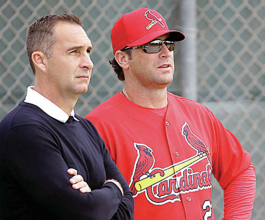 The Cardinals Friday promoted former general manager John Mozeliak, left, to president of baseball operations and named Michael Girsch as GM. Mozeliak is pictured with manager Mike Matheny during spring training in Jupiter, Florida. Photo: AP