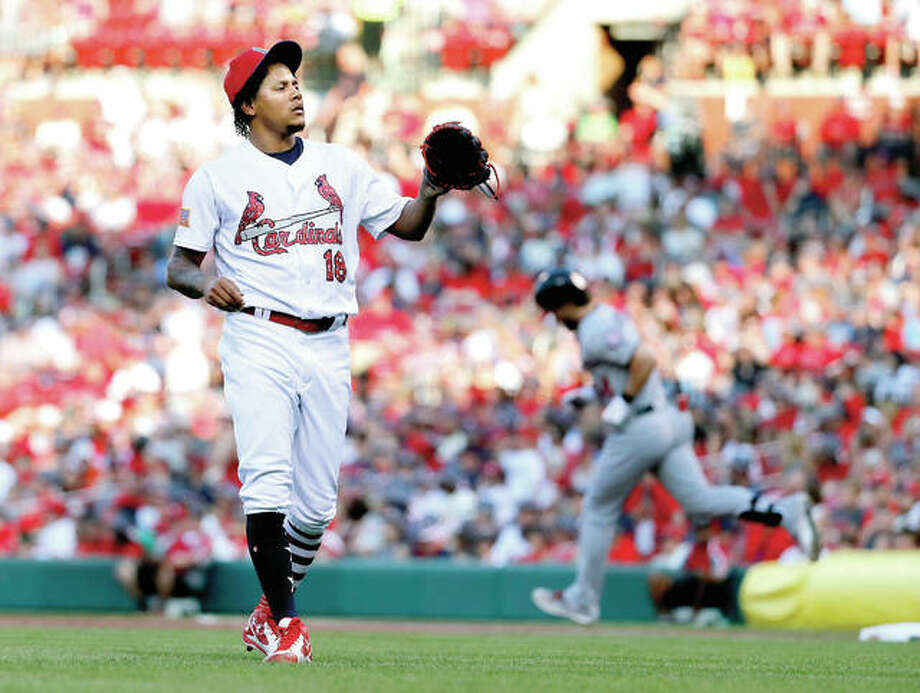 Cardinals starting pitcher Carlos Martinez (18) waits for a new baseball as the Washington Nationals' Bryce Harper rounds the bases after hitting a two-run home run in the first inning Sunday night at Busch stadium. Photo: Jeff Roberson | AP Photo