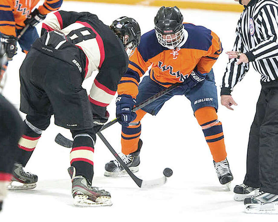 An Illinois player, left, and an SIUE player face off during a club ice hockey game at the East Alton Ice Arena. Illinois is studying the feasibility of adding hockey as a varsity sport. Photo: Telegraph File Photo