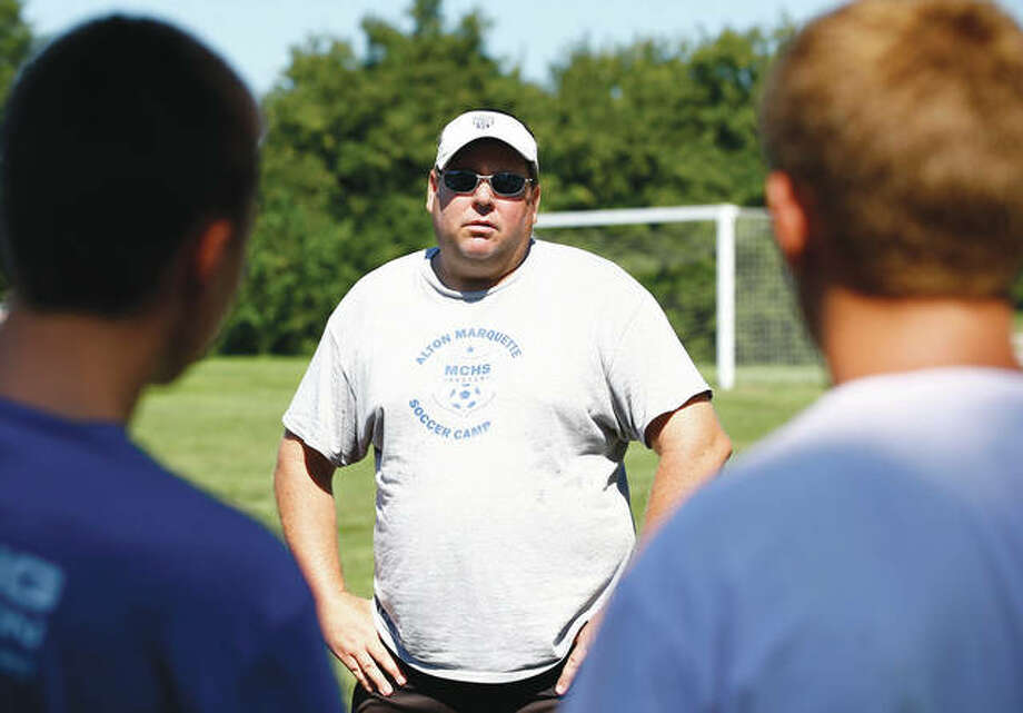 Jeremy Sanfilippo of Marquette is The Telegraph's Small-Schools Boys Soccer Coach of the Year. Sanfilippo, who stepped down after last season, is shown speaking with his team during a practice. Photo: Telegraph File Photo