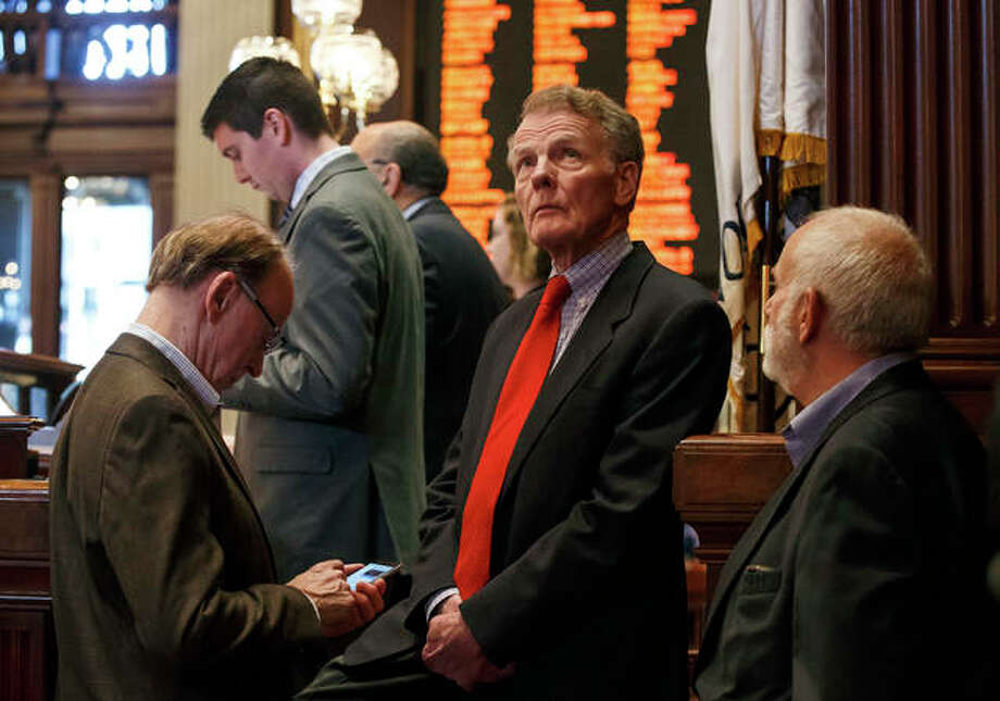 Illinois Speaker of the House Michael Madigan, D-Chicago, looks up towards the video boards during the overtime session at the state Capitol, Sunday, July 2, 2017, in Springfield, Ill. The Illinois House has approved an income tax increase as part of a plan to end the nation's longest budget standoff. (Justin L. Fowler/The State Journal-Register via AP)