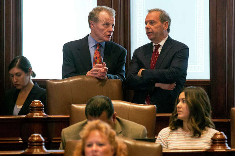 House Speaker Michael Madigan, D-Chicago, left, and Senate President John Cullerton, D-Chicago, talk on the Senate floor Tuesday, July 4, 2017, at the Capitol in Springfield, Ill. The Illinois Senate has OK'd an annual spending plan of $36 billion following a critical vote to raise the income tax rate. If approved by Republican Gov. Bruce Rauner, it would be Illinois' first budget in more than two years. (Rich Saal/The State Journal-Register via AP)