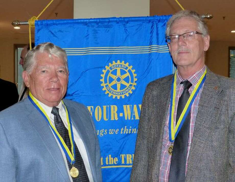 Newest Paul Harris Fellows Chuck West and Tim Hinrichs. Photo: For The Telegraph
