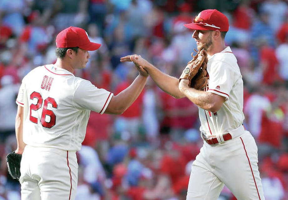 The Cardinals' Paul DeJong, right, and relief pitcher Seung-Hwan Oh celebrate following Saturday's 4-1 win over the Mets at Busch Stadium. DeJong had four hits. Photo: Jeff Roberson | AP Photo