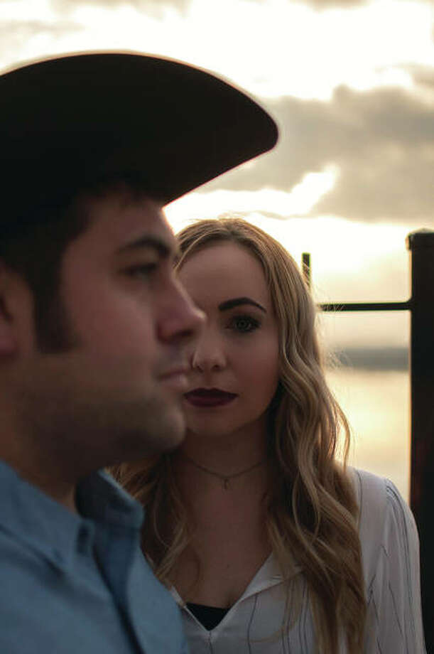 "Alton-based Hymn River Suite, a duo made up of siblings Justin Mathenia and Amy Snyder, tell relatable experiences, through song, that are both common and/or inspiring to listeners and fans. The duo's new CD, ""Hundred Proof,"" distributed by Sony Music's division CEN/The Orchard, is set to release Aug. 11. Photo: Photo Credit Ash Dale