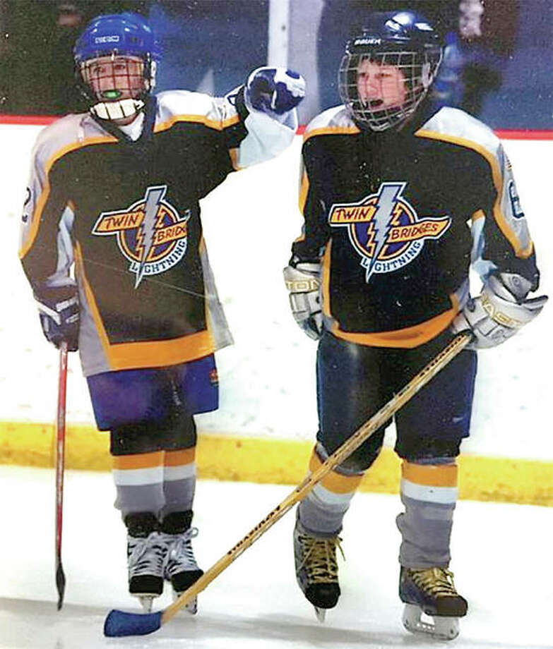 Nick Edwards, left, and teammate Taylor Emerick as 11-year-old Twin Bridges Hockey Club teammates. They later played together at SIUE and are now the Cougars' co-coaches. Photo: Submitted Photo