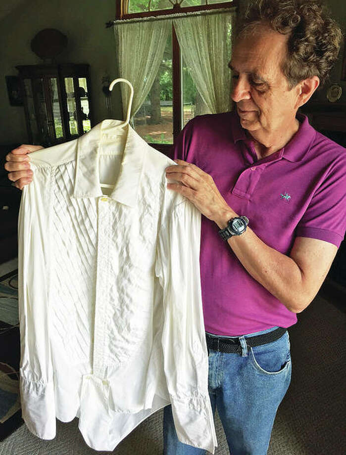 Jim Wiemers holds a tuxedo shirt that he purchased at a used clothing store in California, believed to have once belonged to Frank Sinatra.