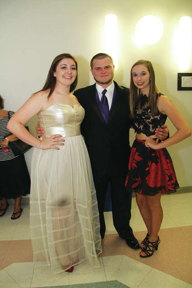 Frew's Bridal and Formal Wear models Lexi Witzig, Matt Sarhage and Emily Gray are all Friends of Wings Illinois youth board members. Photo: For The Telegraph