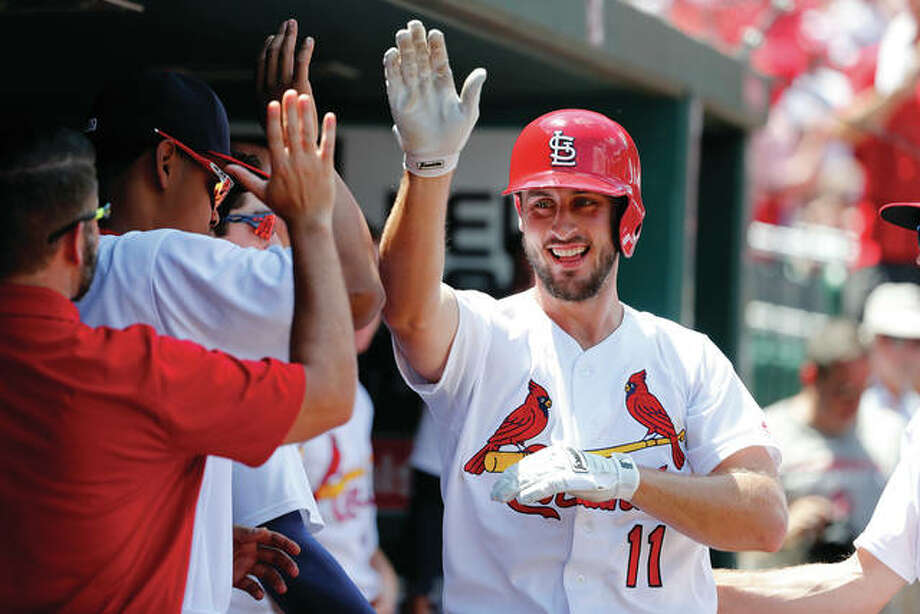 The Cardinals' Paul DeJong is congratulated by teammates after hitting a home run during the fourth inning of the Cards' win over the New York Mets last Sunday at Busch Stadium. DeJong is considered one of the top rookies to watch in the second half of the season, which gets under way Friday in Pittsburgh for the Cardinals. Photo: AP