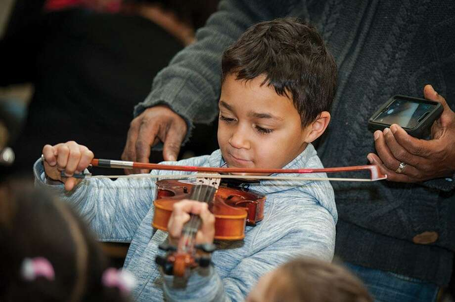 The New Haven Symphony Orchestra will present free family concerts Feb. 17-18 in New Haven and Shelton in association with Connecticut's Beardsley Zoo in Bridgeport. Photo: NHSO / Contributed Photo / Photo: © Joe Crawford. You may tag friends, or share this photo, but do not crop or alter it in any way. Thank you.