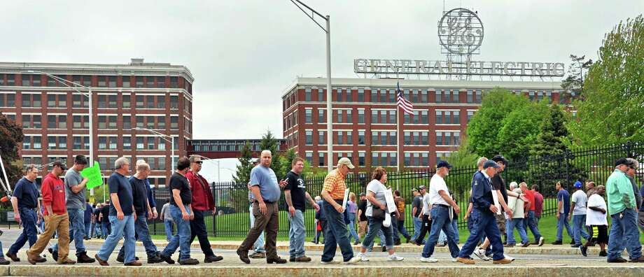 Supporting union workers join retired General Electric employees to protest for cost of living increases on Thursday May 15, 2014, outside the main gate at GE in Schenectady, N.Y.  (John Carl D'Annibale/Times Union archive) Photo: John Carl D'Annibale, Albany Times Union / 00026903A