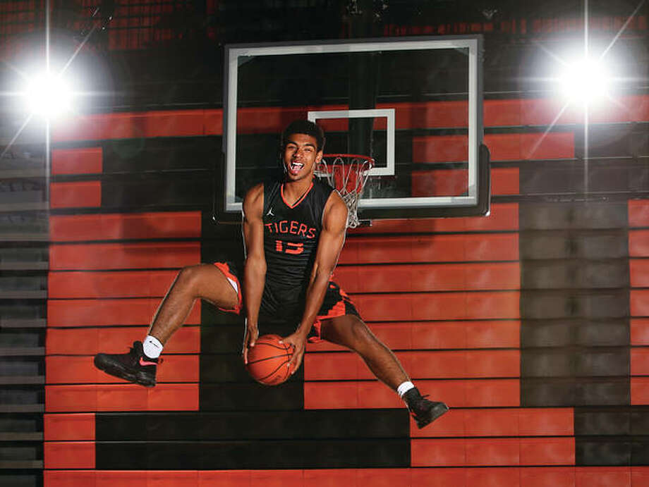 Edwardsville's Mark Smith is the 2016-17 Telegraph Large-Schools Boys Basketball Player of the Year. The 6-foot-5 Smith was named the state's Mr. Basketball and signed with Illinois after leading the Tigers to a 30-2 season. Photo: Billy Hurst / For The Telegraph