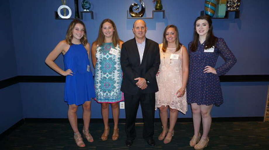 Wood River Refinery Manager Jerry Knoyle, center, congratulates the Phillips 66 Dependent Scholarship recipients, from left, Samantha Mann, Marisa Barton, Makenzi Wilson and Olivia Freeman. Photo: For The Telegraph