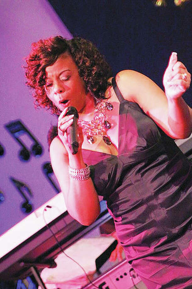 Like Whitney Houston, Danita Mumphard, pictured, started out singing gospel in churches when she was young before expanding her repertoire to include soul and R&B. And also like Houston, Mumphard is a versatile vocalist with a multiple octave voice range. Photo: Submitted Photo|For The Telegraph