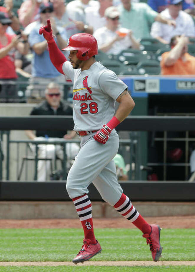 The Cardinals' Tommy Pham reacts after hitting a solo home run in the eighth inning against the Mets on Thursday in New York. Photo: Associated Press