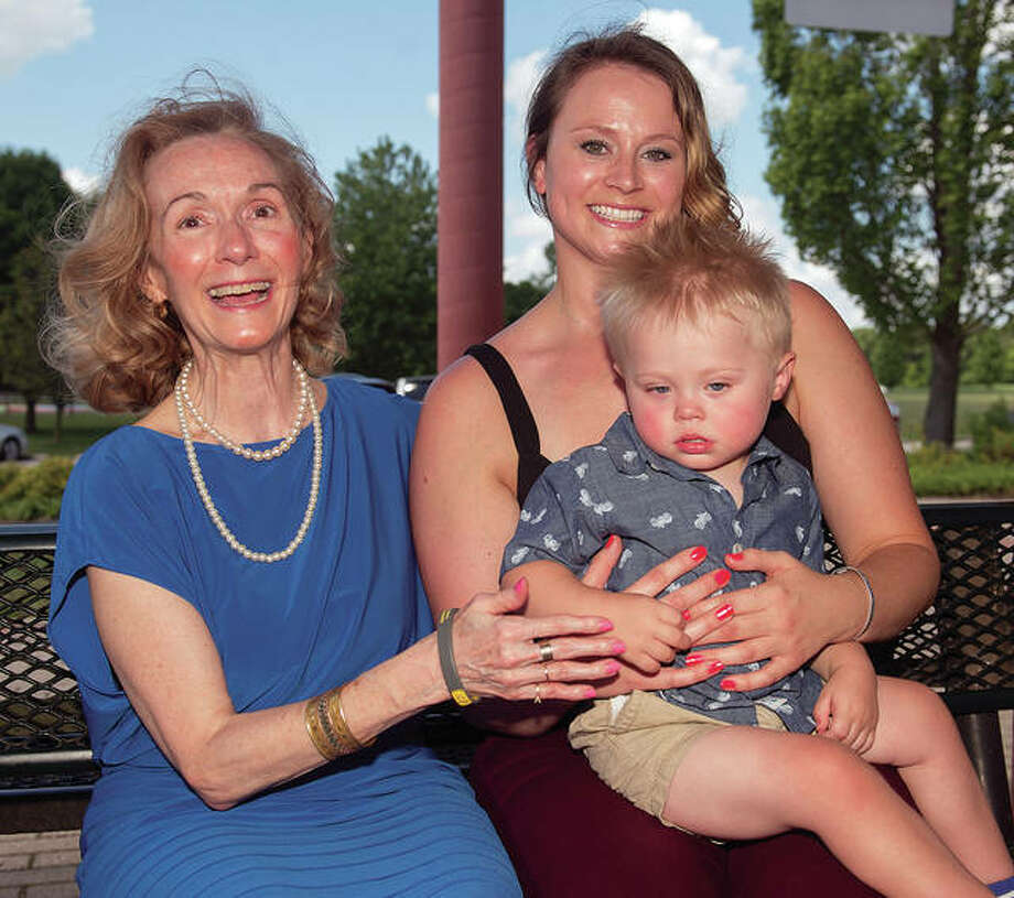 American Lung Association (ALA) key volunteer and ALA event coordinator Jaris Waide, left, of Godfrey, with Jamie Stumpf Stunkel, with her son Logan, 1. Stunkel is a SIUE alumna and Logan was diagnosed with asthma, along with other respiratory issues, at the age of 6 months. They are pictured at the recent American Lung Association's check presentation July 14 at Glazebrook Park in Godfrey. Photo: Photo Credit Mary Christensen|For The Telegraph