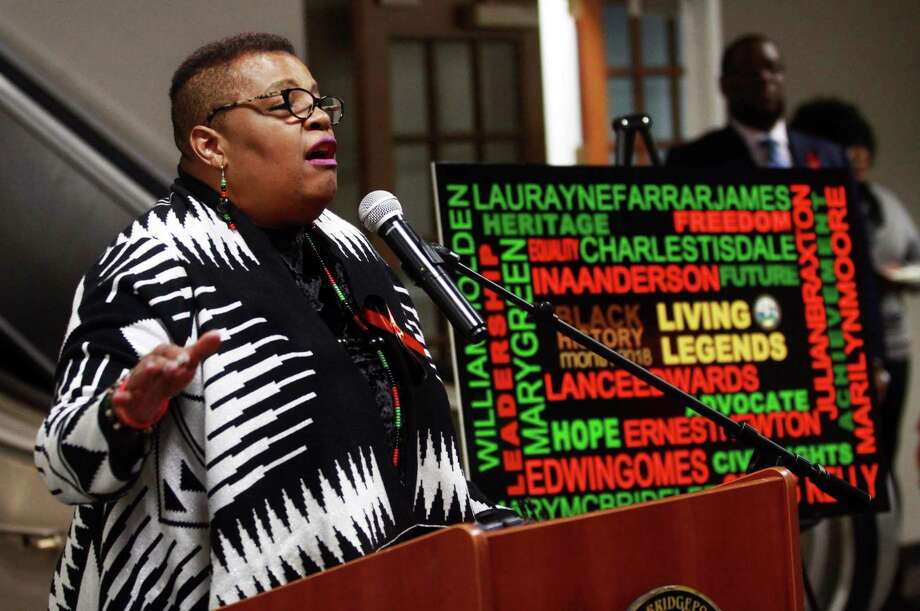 "Rev. Ina Anderson sings the National Negro Anthem ""Lift Every Voice and Sing"" during the Margaret E. Morton Goverment Center's First Annual Bridgeport ""Living Legends"" Recognition Ceremony in Bridgeport, Conn., on Thursday Feb. 8, 2018. Mayor Joe Ganim and the City of Bridgeport honored 12 unsung African American heroes from the Bridgeport community for Black History Month. Rev. Anderson was one of the 12 who was honored. Actor and activist Tenisi Davis gave remarks. Davis, a Bridgeport native, appears on the CBS show Blue Bloods. Spoken Word and musical selections were performed by students at the University of Bridgeport's Sophisticated Love of the Artistic Mind Club (SLAM). Local artisans  Nanette Malone, Gale Clay and others sold their jewelry, crafts and artwork. Photo: Christian Abraham / Hearst Connecticut Media / Connecticut Post"