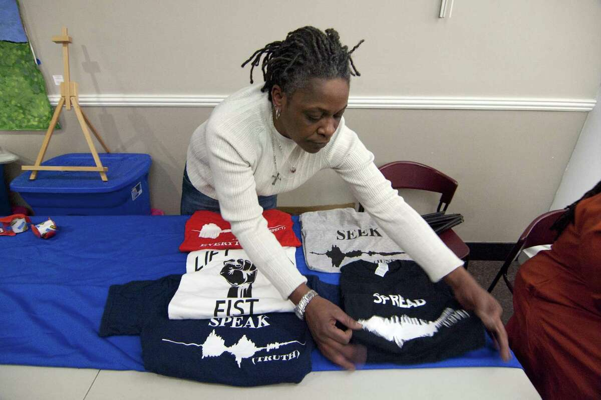 Gale Clay, of Waveformz Visual Speech, puts out T-shirts she has created to sell during the Margaret E. Morton Goverment Center's First Annual Bridgeport