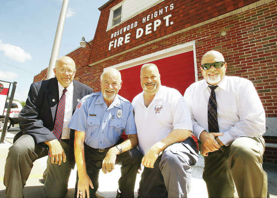 Two went one way, the other two another, as to which one was the right path, you'll have to be a fly on the wall at a Bunt family gathering. The Bunt dynasty of public service produced two firefighters and two police officers. From the left, retired Madison County Sheriff's Office Capt. Don Bunt Jr.; the father of the Bunt boys, celebrating 50 years of service at Rosewood Heights Fire Protection District, Don Bunt Sr.; current Rosewood Heights Fire Chief Tim Bunt; and Wood River Police Deputy Chief Dan Bunt. Photo: John Badman | The Telegraph