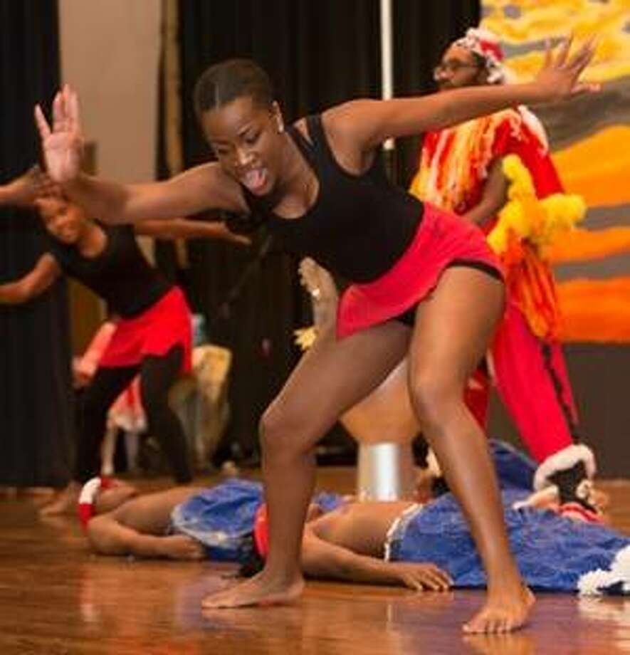 Students, ages 6-17, performed a variety of musical, dance and acting numbers during the SIUE East St. Louis Center's End of the Summer Concert on July 14. Photo: Photos For The Telegraph