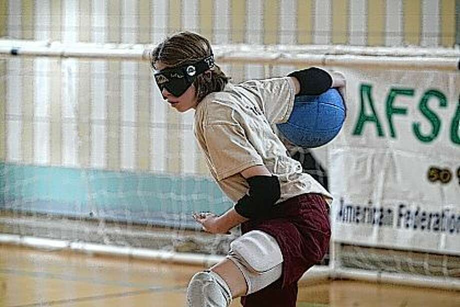 Eighth-grader Tori Lynch plays center during the eighth annual Staff-Student Goalball game Friday at the Illinois School for the Visually-Impaired. Photo: Samantha McDaniel-Ogletree | Journal-Courier