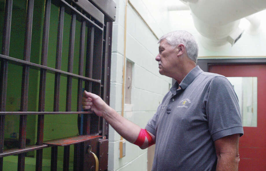 Morgan County Sheriff Randy Duvendack checks the jail cells Monday at the Morgan County Jail. A new law lessens the punishment for possessing small amounts of marijuana, something law enforcement officials in the region oppose. Photo: Samantha McDaniel-Ogletree | Journal-Courier
