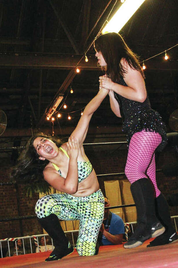 Savanna Stone and Rahne Victoria, both Dynamo Pro Wrestling wrestlers, fight it out. Dynamo Pro Wrestling promoter Jim Yount said Stone is a wrestler to watch for in the future. Photo: Photo Credit Stop Reed Photography|For The Telegraph