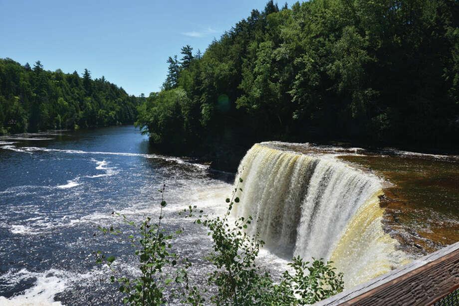 Tahquamenon Falls at Tahquamenon Falls State Park in northern Michigan flows on a sunny summer day. Photo: Jeff Ruzicka | Reader Photo