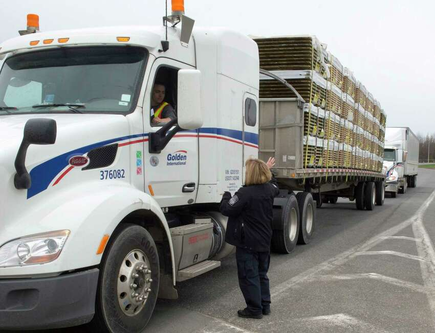 A truck carrying wood goes through the customs checkpoint, Tuesday, April 25, 2017 in Champlain, N.Y. Canadian Prime Minister Justin Trudeau says that Canada and the U.S. could suffer from what he called a