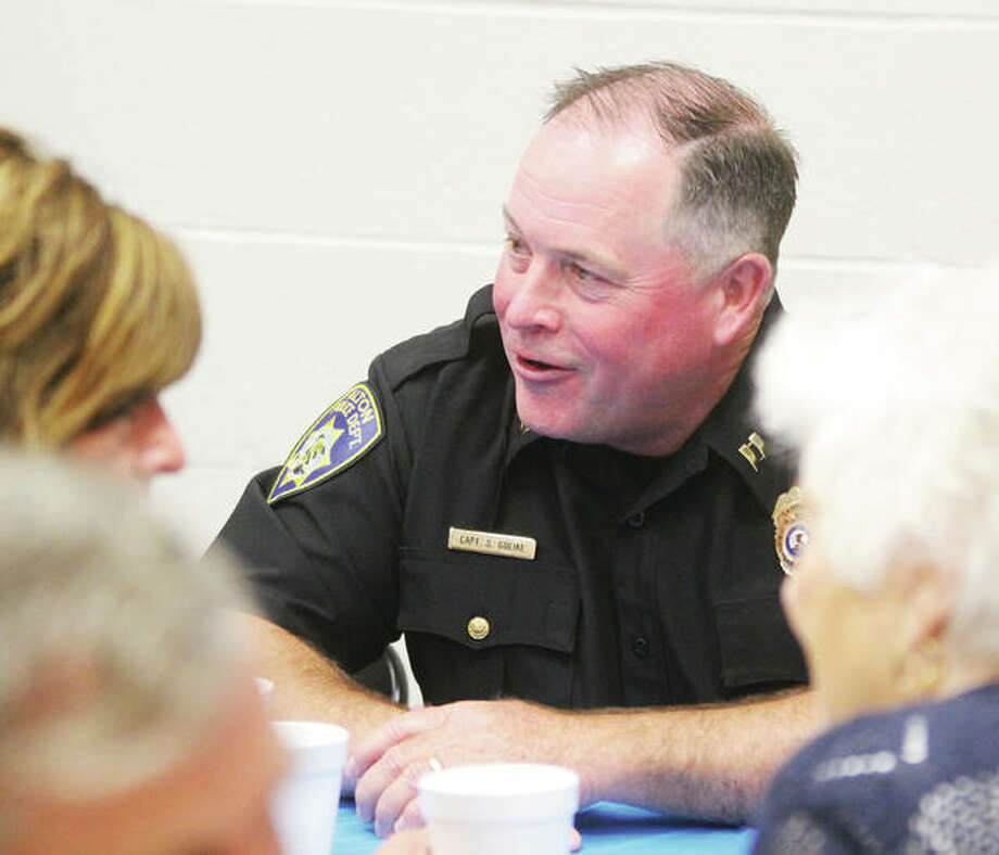 Capt. Scott Golike, of the Alton Police Department, met with well-wishers Thursday at a luncheon honoring his 27.5 years service, much of which were spent as a detective. Golike's last day of work is Friday. Photo: Scott Cousins | The Telegraph