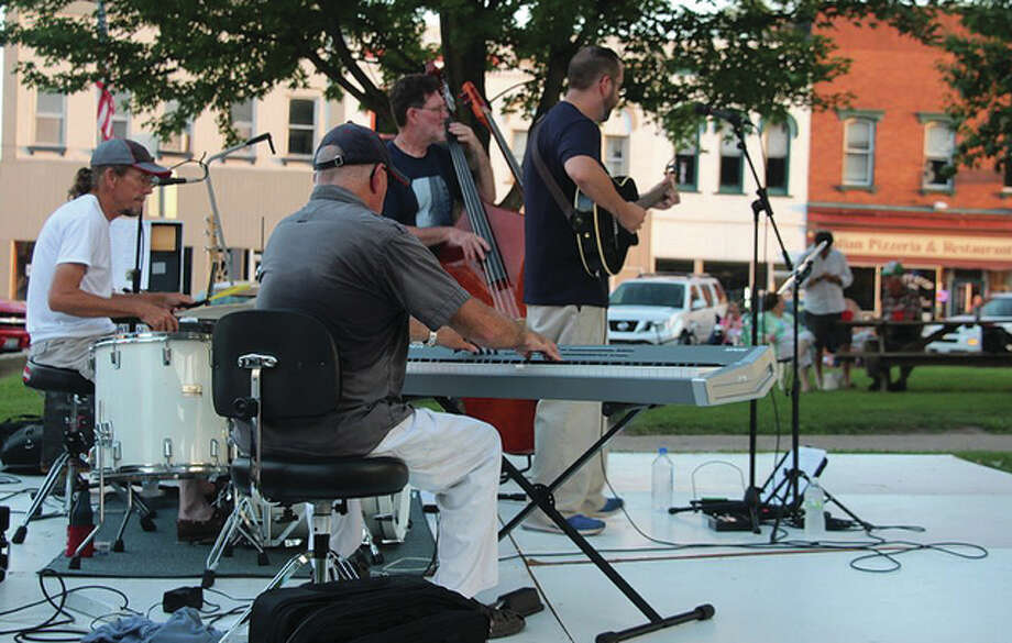 Jeff Newman and the Hot Town Trio fill the downtown Winchester square with music Thursday. The members of the band are Steve Dawson on drums, Pat Brannan on piano and Rob Killam on bass. Photo: Jeff Davidsmeyer | Reader Photo