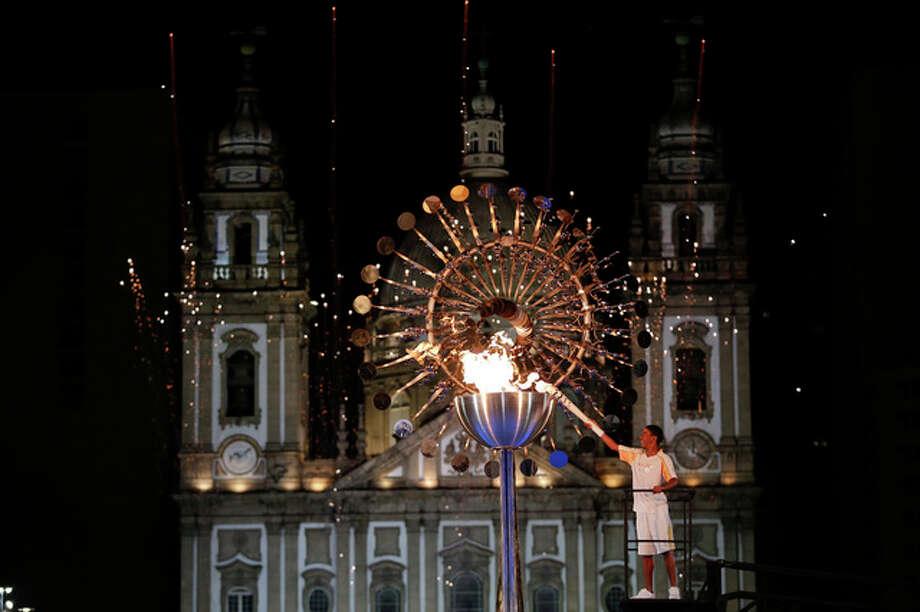 Jorge Alberto Oliveira Gomes lights the Olympic cauldron during the opening ceremony of the 2016 Summer Olympics in Rio de Janeiro, Brazil, Saturday, Aug. 6, 2016. (AP Photo/Natacha Pisarenko)