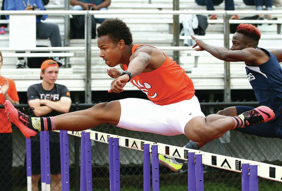 Edwardsville's Travis Anderson leads the field in the 110-meter high hurdles as a junior in 2016 at the Collinsville Class 3A Sectional. He went on to win state in the event for the first of his three state titles for the Tigers. Photo: Billy Hurst / For The Telegraph