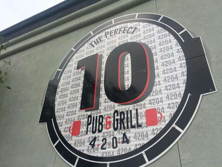 New signs have gone up on the building that, until last week, was 4204 Main Street Brewing Co. The rebranded restaurant — now named The Perfect 10 Pub — focuses on upscale, casual American food. Photo: Alex Heeb|The Telegraph
