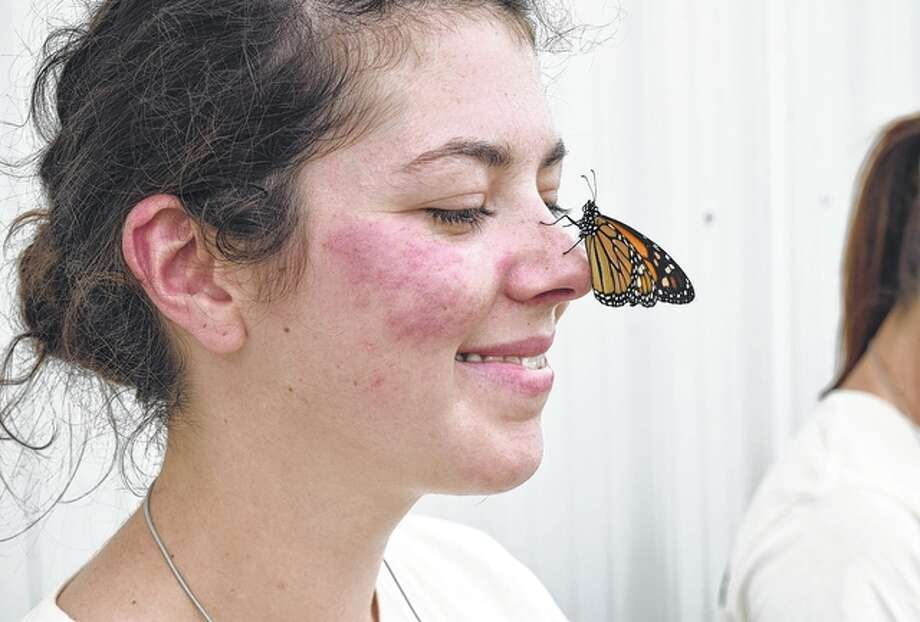 Jennie Dodds, agriculture teacher at Virginia High School, watches a monarch butterfly on her nose during a field trip to the Byron and Anita Moody farm south of Chapin. Photo: Greg Olson | Journal-Courier