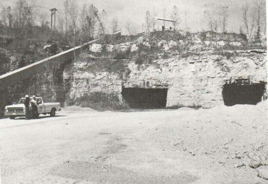 """In 1855, The Alton Courier predicted that the manufacture of lime would be of great importance to the industrial base of the city. Four firms were operating at that time and limestone was plentiful, """"under each Alton hill, apparently, was a limestone deposit."""" Mississippi Lime purchased the John Armstrong Lime and Quarry Co. in 1895. Lime was used in the manufacture of glass, paper, and ammonia. From the simple mines of the last century, Mississippi Lime has grown to lead the industry. The caves were typical of the limestone mining operation. Photo: File Photo"""