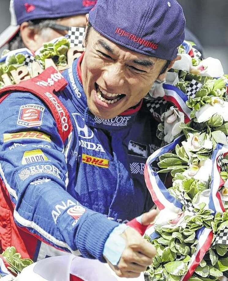 Takuma Sato, of Japan, who won this year's Indianapolis 500, will drive in the inaugural Bommarito Automotive Goup 500 Aug. 26 at gateway Motorsports park. Sato is shown as he celebrates on the Yard of Bricks after winning the Indy in May. Photo: AP
