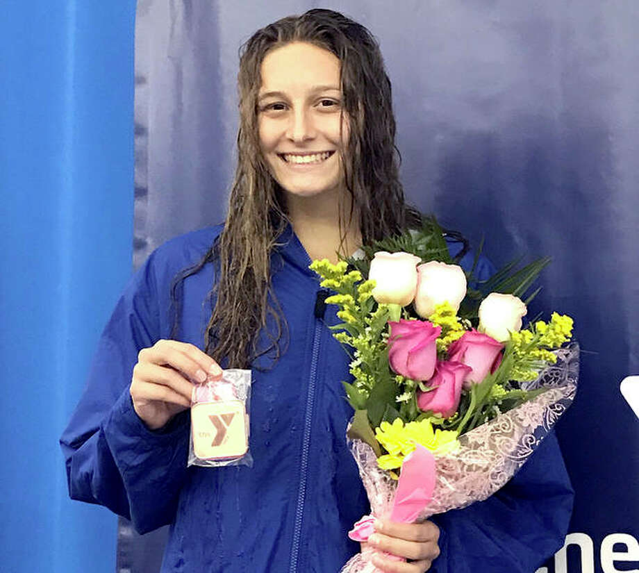 Bailey Grinter of the Edwardsville YCMA Breakers smiles on the awards stand after her sixth-place finish Tuesday night in the finals of the girls 20-meter backstroke at the YMCA Long Course Nationals in Greensboro, North Carolina. Photo: Submitted Photo
