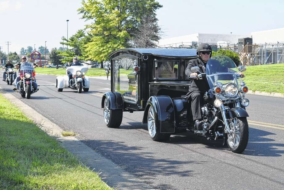 A unique hearse gives motorcycle enthusiast Davids Richards, 59, one last ride Thursday down Lincoln and Morton avenues after leaving Williamson Funeral Home. Photo: Nick Draper | Journal-Courier