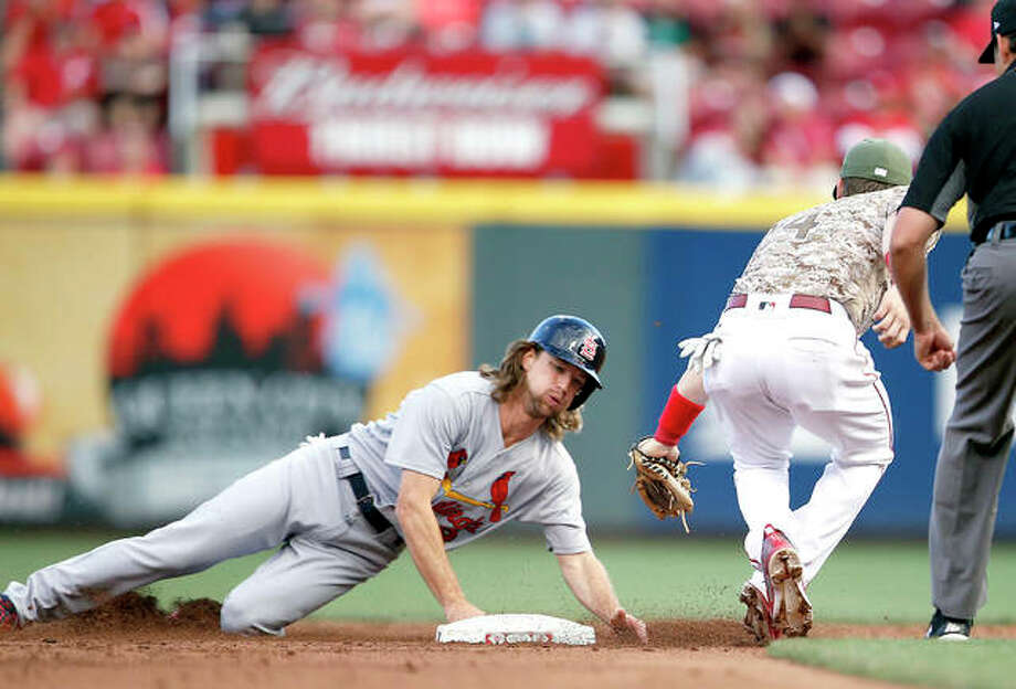 The Cardinals' Mike Leake, left, is out at second base while trying to advance on a fly ball as Cincinnati Reds second baseman Scooter Gennett makes the tag in the third inning Friday night in Cincinnati. Photo: AP