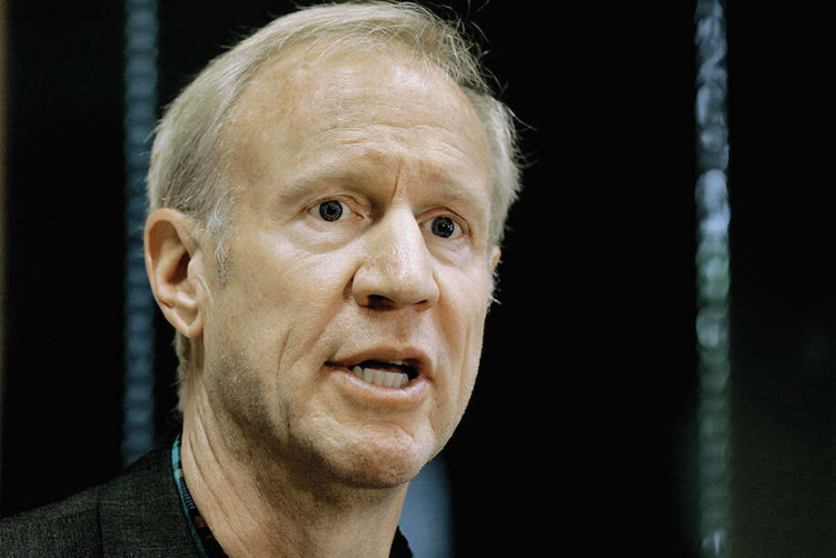 Seth Perlman | AP Gov. Bruce Rauner speaks to reporters in Taylorville. A stopgap spending plan that lawmakers approved this summer in the midst of a long-lasting budget crisis is quickly draining the state's rainy day fund. As of Friday, it had about $180 million. In a matter of weeks, the balance will be zero.