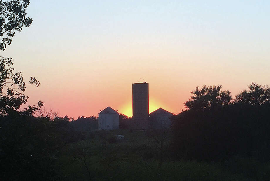 The sun sets on another day behind a farm south of Franklin. Photo: Reggie Toler | Reader Photo
