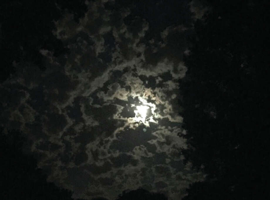 Clouds partially obscure the moon over Jacksonville, providing an eerie appearance to the night sky. Photo: Jean Nance | Reader Photo